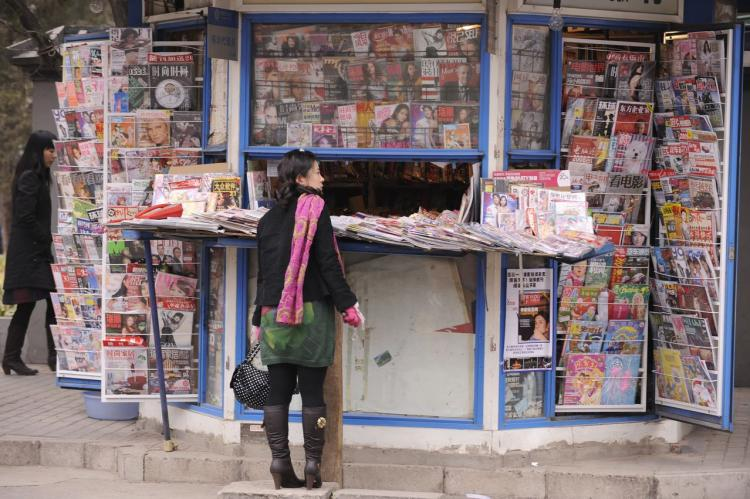 Newspapers and magazines on sale at one of Beijing's many news stands. (Peter Parks/AFP/Getty Images)