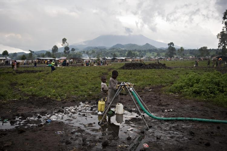 People, who have been displaced by violence in the  Democratic Republic of Congo, get water on January 28, 2009 in their camp for internally displaced people. (Walter Astrada/AFP/Getty Images)