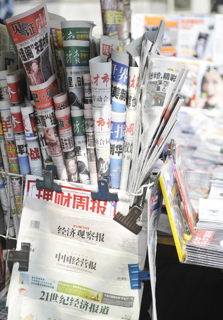 Various newspapers and magazines are seen at a roadside stall in Beijing on April 7, 2009. (EMILIE MOCELLIN/AFP/Getty Images)