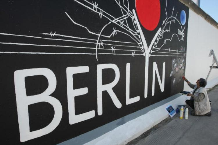 Murals decorate a surviving portion of the Berlin Wall. Germany will mark 20 years since the fall of the Wall with an international commemoration in November. (Sean Gallup/Getty Images)