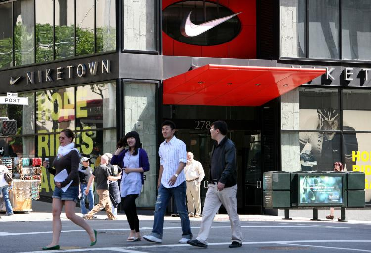 Pedestrians walk by a NikeTown store May 15, 2009 in San Francisco, California. In 2009, 56 percent of mainland Chinese's luxury purchases were made abroad (including Hong Kong and Macau), amounting to 87 billion yuan, or US$13.4 billion.   (Justin Sullivan/Getty Images)