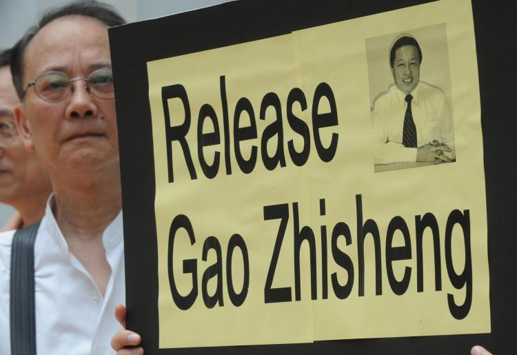 Calling for the release of Gao Zhisheng, a supporter attends a protest and holds a placard in Hong Kong in 2009. (Mike Clark/AFP/Getty Images)