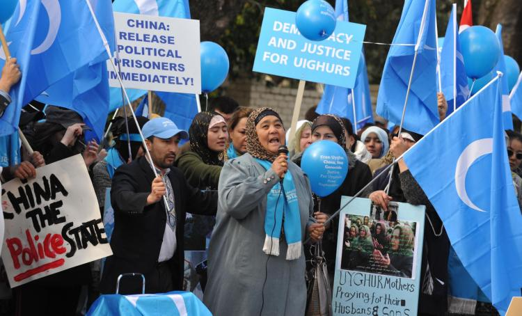 A protest outside the Chinese Consulate in Melbourne as Uyghurs accuse the Chinese Communist Party of atrocities against protesters in Urumqi. (Paul Crock/AFP/Getty Images)