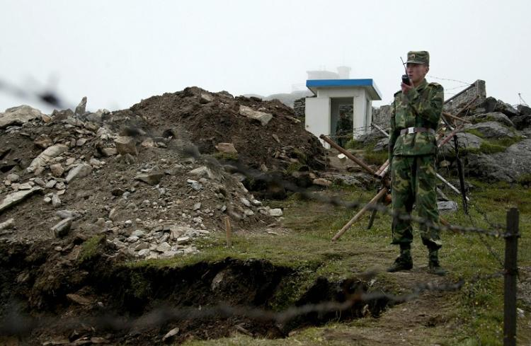 INDO-TIBETAN PATROL: Chinese soldier patrolling the Sikkim border.India and China reached an agreement in 1996 in which both sides pledged not to open fire for any reason. (Photo taken on July 10, 2008.) (DIPTENDU DUTTA/AFP/Getty Images)