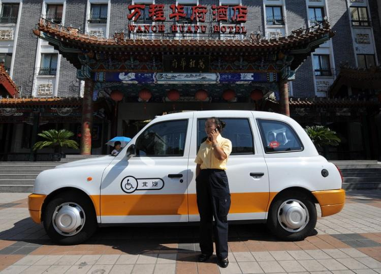Currently 70,000 taxis in Beijing are equipped with a micro-monitor. The monitor connects to a GPS system via satellite. (Getty Images)