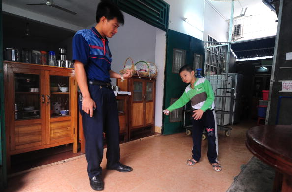 Huang Zhuoxiang, who suffers from cerebral palsy