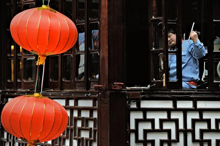 Cleaning windows in Shanghai on February 10, 2010 in preparation for the Chinese new year.(Philippe Lopez/AFP/Getty Images)