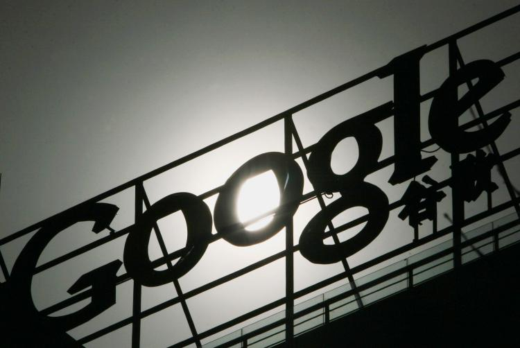 The Google logo on the rooftop of Google China's head office building in Beijing on March 21, 2010. Google stopped censoring Internet search results in China on March 23 in a move that was hailed by rights groups but drew an angry reaction from the Chine (AFP/Getty Images)