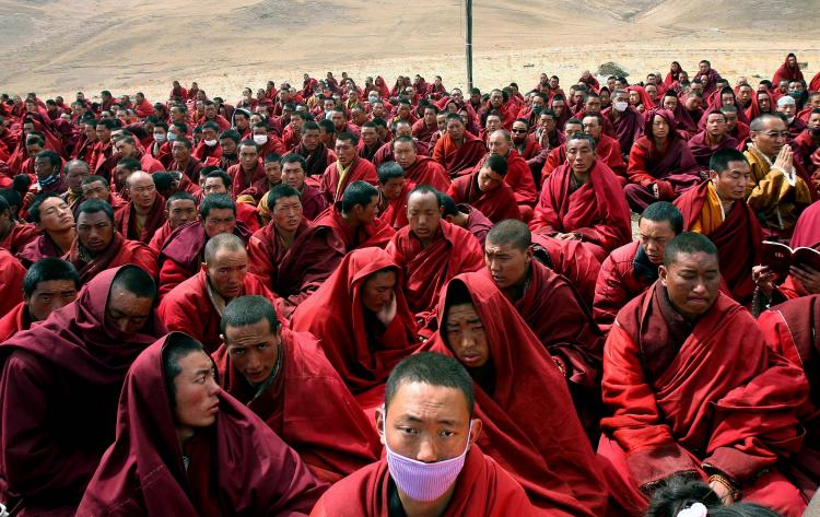 Tibetan monks gather outside their destroyed monastery in Jiegu, Yushu county, in China's northwestern province of Qinghai on April 20. (AFP/Getty Images)