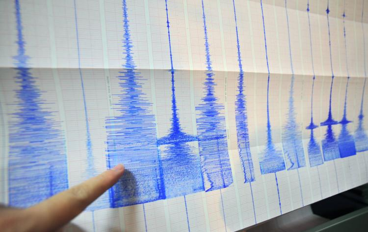 A man points at a seismic chart at the Central Weather Bureau in Taipei on March 4, 2010 after a 6.4 magnitude rocked southern Taiwan near the island's second largest city of Kaohsiung. The quake hit about 70 kilometres (about 40 miles) from the main south. (Sam Yeh/AFP/Getty Images)