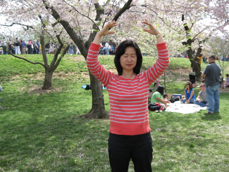 Cui Aidong, Cui Aimin's sister, practices one of the Falun Gong