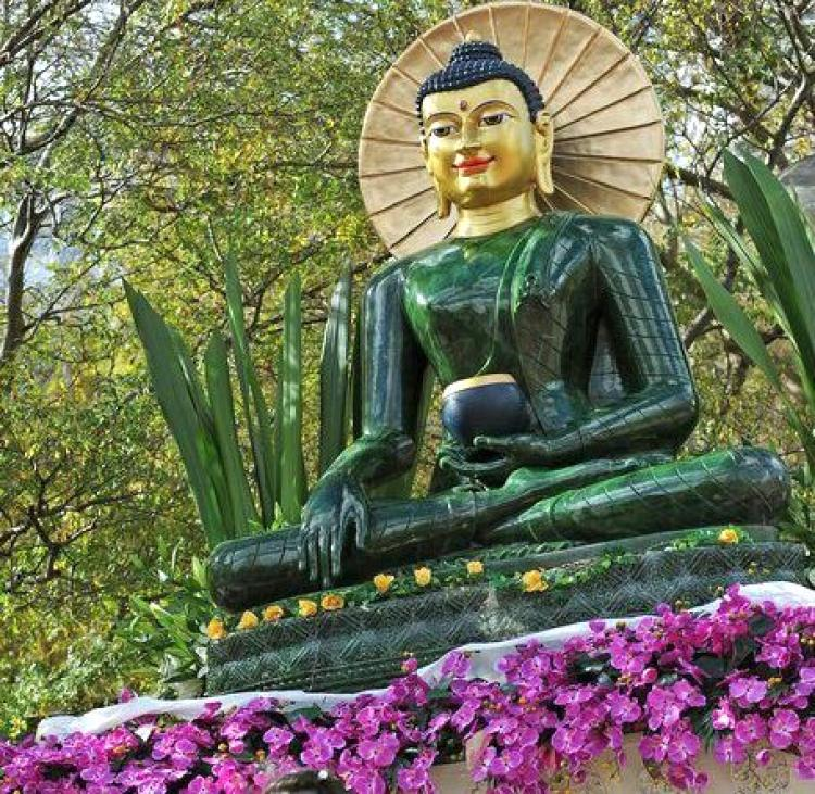 The Jade Buddha for Universal Peace, displayed here in Sydney in 2009, is the largest Buddha figure carved from gemstone quality nephrite jade. The statue was carved from a rare18-ton boulder discovered at the Polar Jade mine in northwestern British Columbia. (GREG WOOD/AFP/Getty Images)