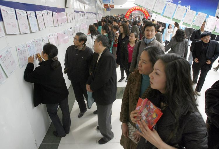 Locals browse through singles information at a 'lover's finding,' or matchmaking event for Valentines Day in Chengdu, Sichuan Province, in 2007. (AFP/Getty Images)