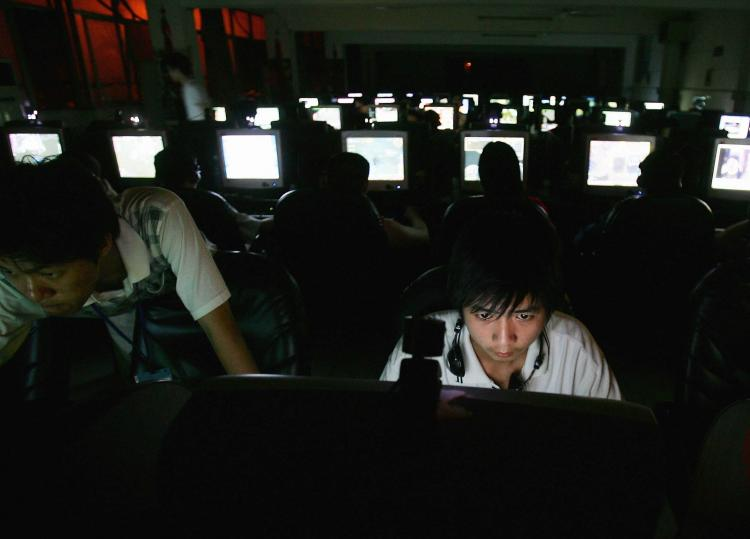 A young man in a cyber cafe in Wuhan, China sits at work at a computer. The Chinese regime encourages individuals known as 'patriot hackers' to steal information from governments and companies. (Cancun Chu/Getty Images)