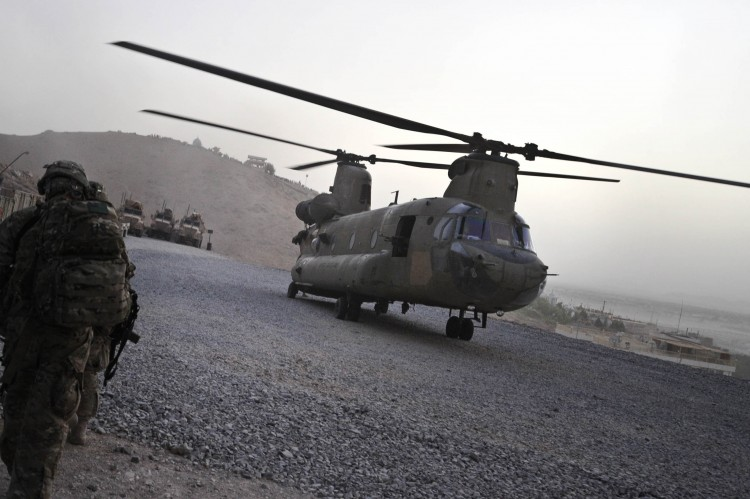 A U.S. military Chinook helicopter is seen landing at Forward Operating Base in Arghandab District in southern Afghanistan on July 29. (Romeo Gacad/AFP/Getty Images)