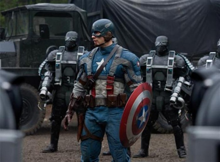 DANGEROUS COMPANY: Captain America (Chris Evans, center), surrounded by Hydra Soldiers in the action-adventure movie 'Captain America: The First Avenger.'  (Courtesy of Jay Maidment / Marvel Studios)