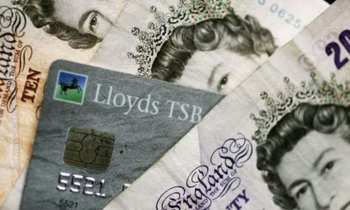 A chip-and-PIN card is mixed in with Bank of England notes. (Christopher Furlong/Getty Images)