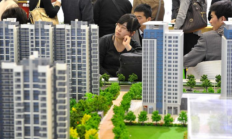 Chinese house shoppers gather at a property fair in Beijing on August 2, 2010. (AFP/Getty Images)