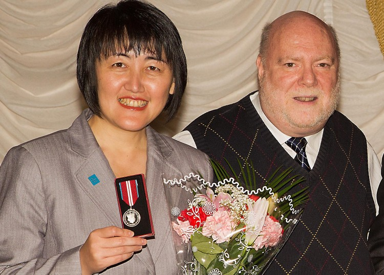 Epoch Times publisher Cindy Gu stands with Sanderson Layng, Vice President and Chief Operating Officer of the Canadian Centre for Abuse of Awareness (CCAA)