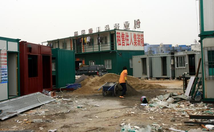 The sign reads 'Cargo Shipping Container House for Rent/Purchase' (The Epoch Times Archives)