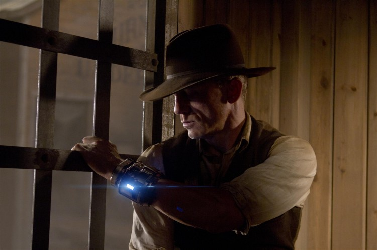 BEHIND BARS: Daniel Craig as a stranger with no memory of his past, in the action sci-fi thriller 'Cowboys & Aliens.' (Zade Rosenthal/Universal Studios and DreamWorks II Distribution Co. LLC)