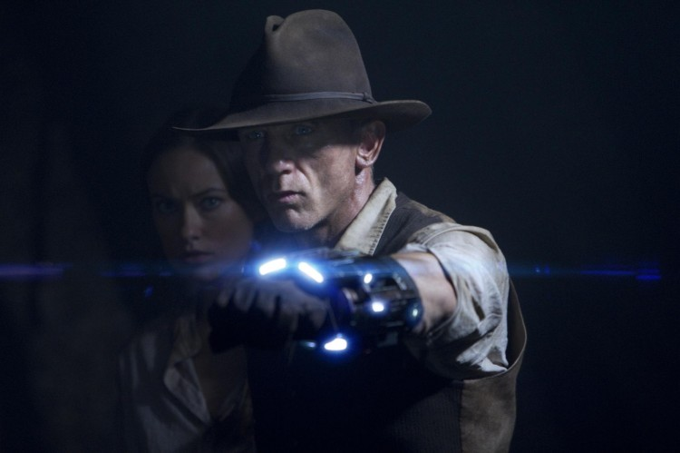 ON GUARD: Olivia Wilde as the elusive traveler Ella and Daniel Craig as a stranger with no memory of his past, in the action sci-fi thriller 'Cowboys & Aliens.' (Zade Rosenthal/Universal Studios and DreamWorks II Distribution Co. LLC )