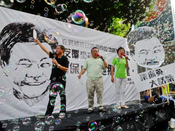 Protesters call Hong Kong's new executive chief Leung Chun-ying a liar,