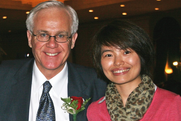 MP Bob Dechert and Xinhua reporter Shi Rong in an undated photo sent to government and media contacts from Shi's email account last week.