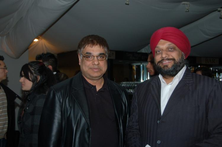 Mr. Jaswal (L) and Mr. Flora,  two business owners and friends,  said they were greatly impressed by the show.  (Matthew Little/The Epoch Times)