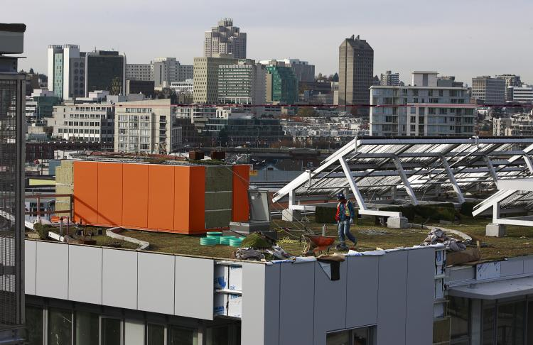 A construction worker walks on a green roof at the 2010 Athletes Village on Nov. 4, 2009, in Vancouver, Canada, host city of the 2010 Olympic Winter Games which began on Feb. 12, 2010. (Jeff Vinnick/Getty Images)