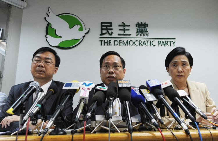 Democratic Party Chairman Albert Ho (C) speaks at a news conference in Hong Kong on May 24. The struggle for democracy in Hong Kong has hit a new level, as clashes erupted over proposed electoral reform. (Mike Clarke/Getty Images)