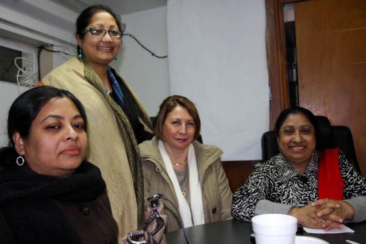 UNITED: Immigrant women support each other as they adjust to life in America in an organization called Sheba USA. Nahid Akthan (L), Tamanna Yasmin (2nd L), Gianne Pollack (2nd R), and Nargis Rahman (R) enjoy some tea and conversation.  (Tara MacIsaac/THE EPOCH TIMES)