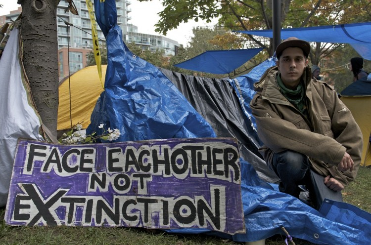 Kyle Bailey came to Toronto's St. James Park from Orangeville, Ontario, to join the Occupy protest 'for as long as it takes,' to see something done to narrow the gap between the rich and poor.  (Matthew Little/The Epoch Times)