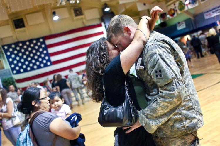 U.S. Army Spc. Tim McCulloch embraces his girlfriend Deanna Meder after arriving home from Iraq on Aug. 23 to Fort Carson, Colo. McCullouch, from the 4th Infantry, is among the many U.S. soldiers returning home from Iraq, as Operation Iraqi Freedom draws to a close. (John Moore/Getty Images)