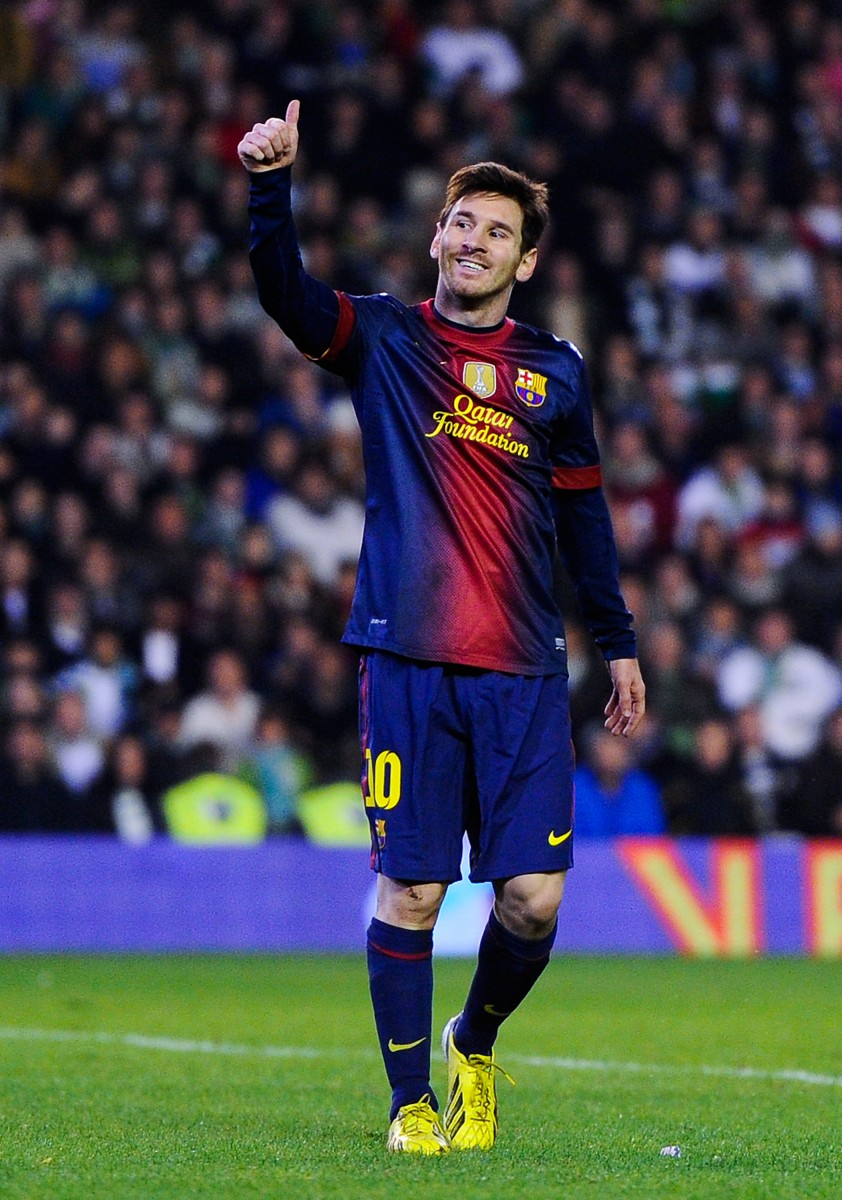 Lionel Messi of FC Barcelona gives his thumbs up during the La Liga match between Real Betis and FC Barcelona at Estadio Benito Villamarin, Dec. 9, 2012 in Seville, Spain. (David Ramos/Getty Images)