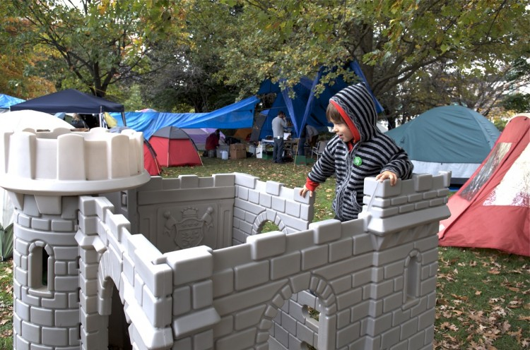 A young boy plays on a castle at the Occupy Ottawa camp in Confederation Park.  (Matthew Little/The Epoch Times)