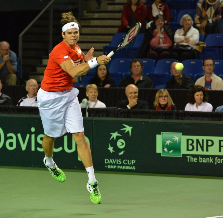 Milos Raonic of Canada fires a forehand against Spain's Guillermo Garcia-Lopez on Sunday at the Thunderbird Sports Centre in Vancouver. Canada advanced past Spain in Davis Cup to reach the quarterfinals. (Don MacKinnon/AFP/Getty Images)