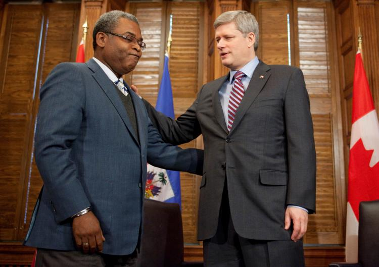 Prime Minister Stephen Harper discusses relief efforts in Haiti with Jean-Max Bellerive, Prime Minister of Haiti, on Jan. 24 in Ottawa. (Jason Ransom)