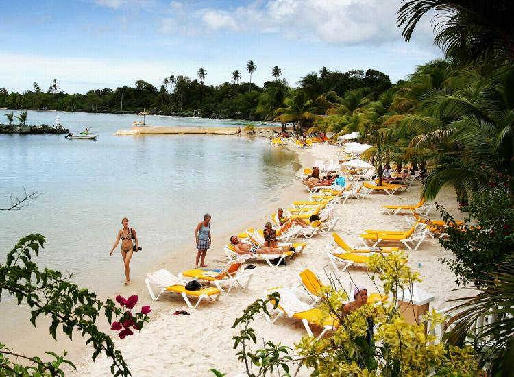 The beach at the Cocoa Resort, a popular sun destination in Trinidad and Tobago. The Caribbean and Mexico are currently the top vacation spots for Canadian tourists. (Chris Jackson/Getty Images)