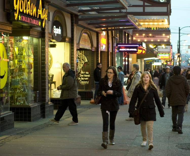 Pedestrians walk down a section of Granville Street in Vancouver lined with small local businesses and a variety of shops. Small Business Week, which celebrates Canadian entrepreneurship, runs from Oct. 17 to 23 this year. (Don Emmert/AFP/Getty Images)
