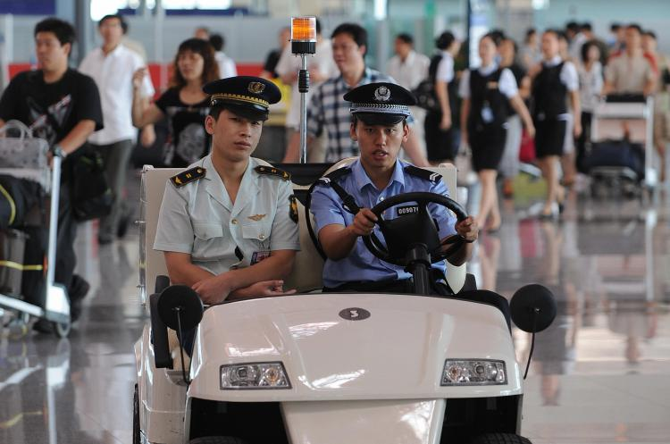 Chinese police patrol the International airport in Beijing.  (Mark Ralston/AFP/Getty Images)