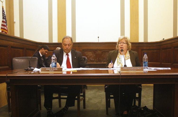 Discussing the U.S. government e-mail traffic hijacking at the press briefing to deliver the annual report of the United States-China Economic and Security Review Commission, Chairman Daniel M. Slane, and Vice Chairman Carolyn Bartholomew.  (Matthew Robertson/The Epoch Times)