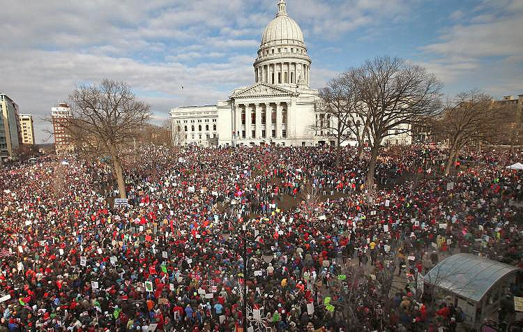 Thousands of demonstrators protest outside the Wisconsin State Capitol on March 12 to voice their opposition to Gov. Scott Walker's budget repair bill, which essentially eliminated collective bargaining rights for state workers. An Alberta union leader fears something similar could happen in Canada. (Scott Olson/Getty Images)