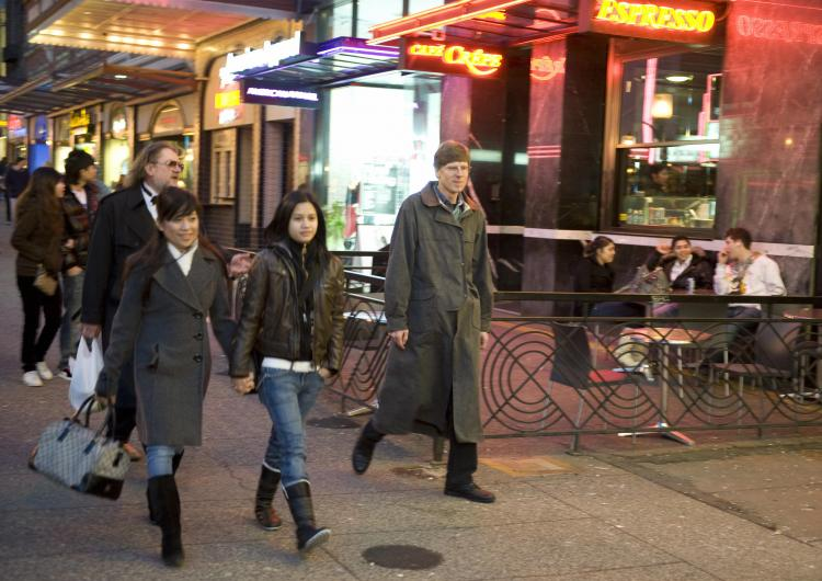 Pedestrians walk past restaurants on Granville Street in downtown Vancouver, British Columbia, on Feb. 7, 2009. When the harmonized sales tax take effect in B.C. on July 1, 2010, customers will pay 12 percent HST on restaurant meals rather than the 5 perc (Don Emmert/AFP/Getty Images)