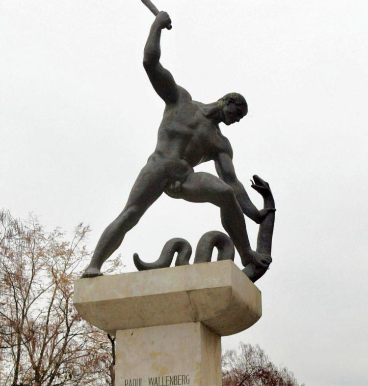 Monuments to Raoul Wallenberg have been built in many countries. This one, in Budapest, Hungary, shows the hero fighting a giant snake. (Attila Kisbenedek/AFP/Getty Images)