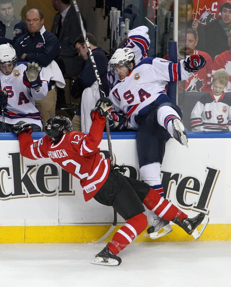 BIG HIT: Canada's Quinton Howden slams into Jerry D'Amigo to set the tone for Canada's game plan. (Rick Stewart/Getty Images)
