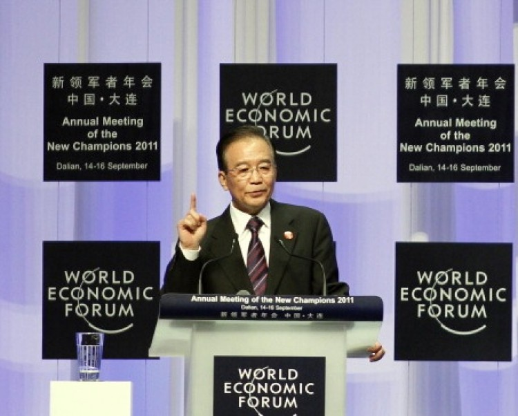 China's Premier Wen Jiabao gestures as he delivers his keynote address at the summer session of the World Economic Forum in the Chinese port city of Dalian, northeast China's Liaoning Province on Sept. 14, 2011. (STR/AFP/Getty Images)
