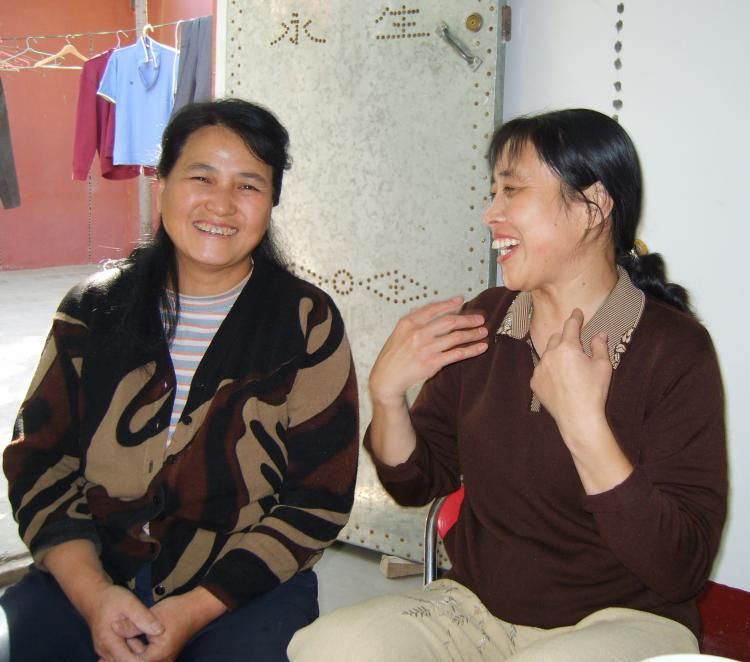 Yang Cuizhou (L) during better times.  (China Aid)