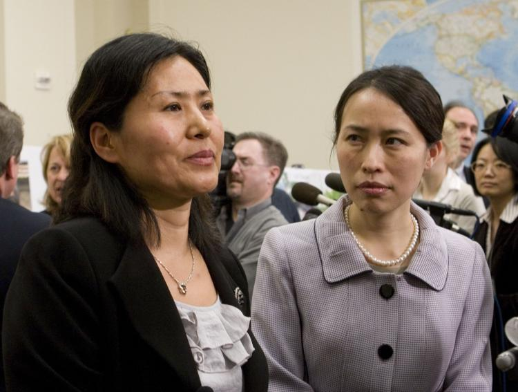 TESTIFYING: Geng He (L) at the Rayburn Building where she gave testimony about the persecution of her husband and family, on Jan. 18. (Lisa Fan/The Epoch Times)