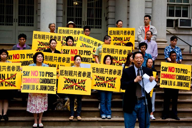 PROTEST: One of the speakers at a rally against John Liu, a candidate for NYC comptroller. (Matthew Robertson/The Epoch Times)